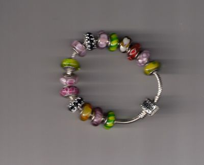 Silver  Bracelet  Complete with  Pandora  Beads