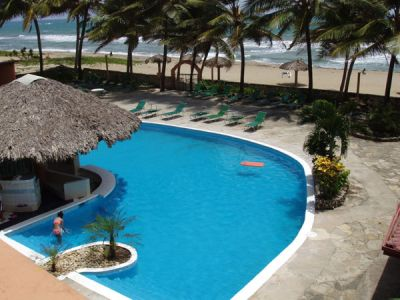 CARIBBEAN BEACHFRONT CONDO JUNE, JULY, AUGUST ONLY $1000 PER MONTH !!